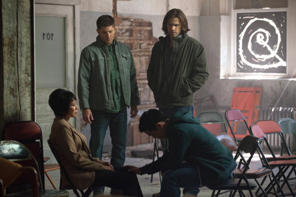 Lauren Tom as Ms Tran, Jensen Ackles as Dean, Jared Padalecki as Sam, and Osric Chau as Kevin — Credit: Liane Hentscher/The CW — © 2012 The CW Network.